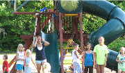 children at a playground at a northern minnesota family resort