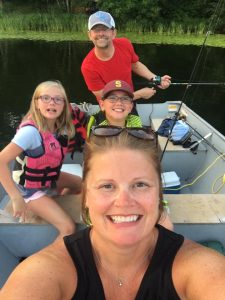 family in a boat at a minnesota family resort