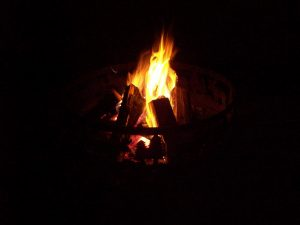 campfire at night during a minnesota family resort vacation