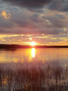 sunset over a minnesota lake resort